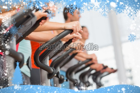 fit people working out at spinning