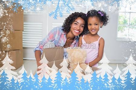 cute daughter unpacking her teddy bear