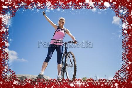 fit pretty cyclist on a rocky