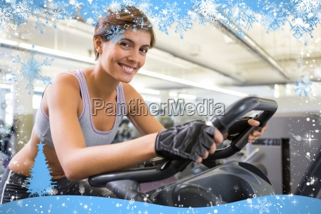 fit smiling brunette working out on