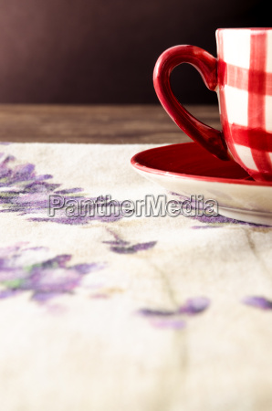 detail of coffee cup laid on