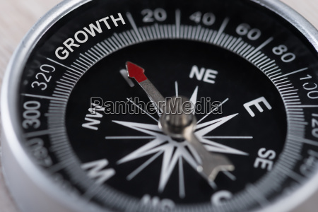 compass indicating growth