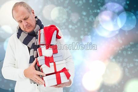 composite image of festive man holding