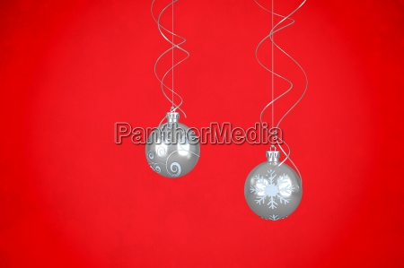 composite image of two hanging silver