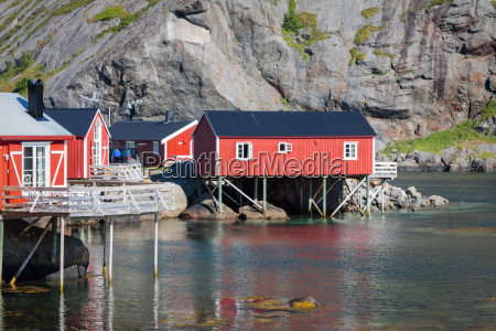 red and yellow wooden fishing cabins