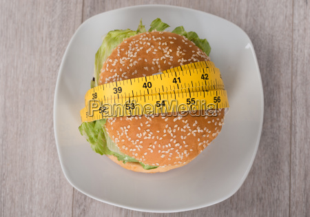 burger wrapped in measure tape on
