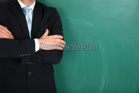 businessman standing over green background