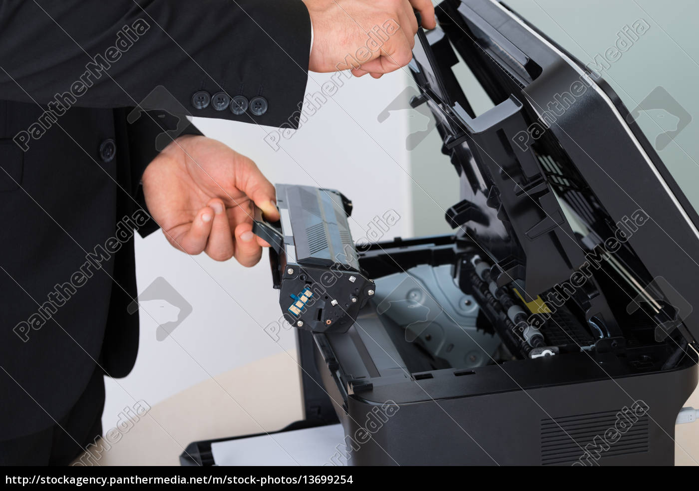 businessman, fixing, cartridge, in, photocopy, machine - 13699254