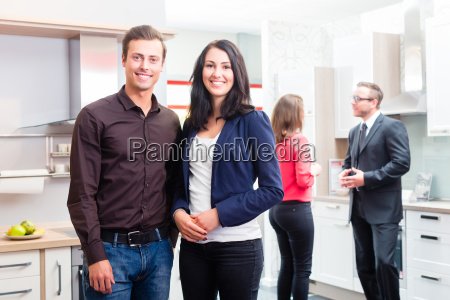 couple looking kitchen in furniture store