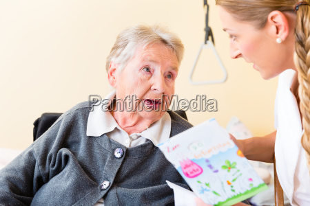 nurse gives old woman in home