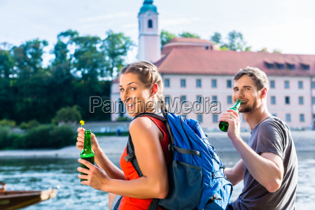 couple hiking at danube monastery weltenburg