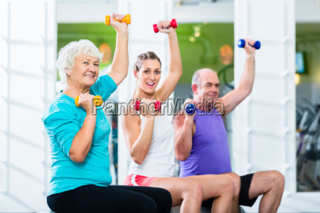 seniors, and, trainers, with, dumbbells, in - 13707534