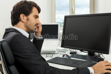 young successful businessman with black suit