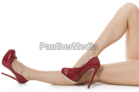 attractive female legs with red high