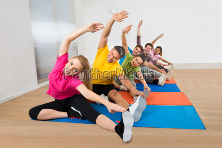 group, of, happy, people, stretching, legs - 13713460