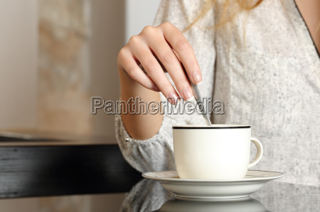 woman hand preparing a cup of