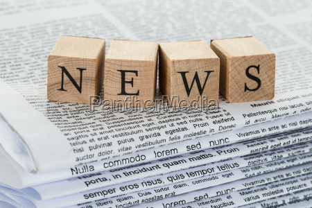 wooden, blocks, spelling, news, on, newspapers - 13716527