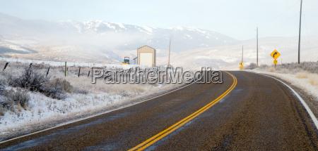 fresh snow blankets hillside rural country
