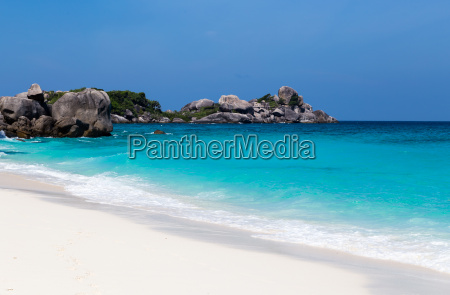 white sand beach and blue sea
