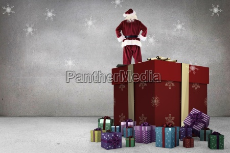 composite image of santa standing on