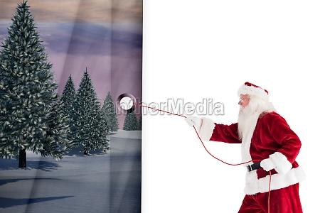 composite image of santa pulls something