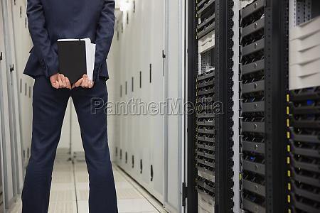 technician standing in server hallway