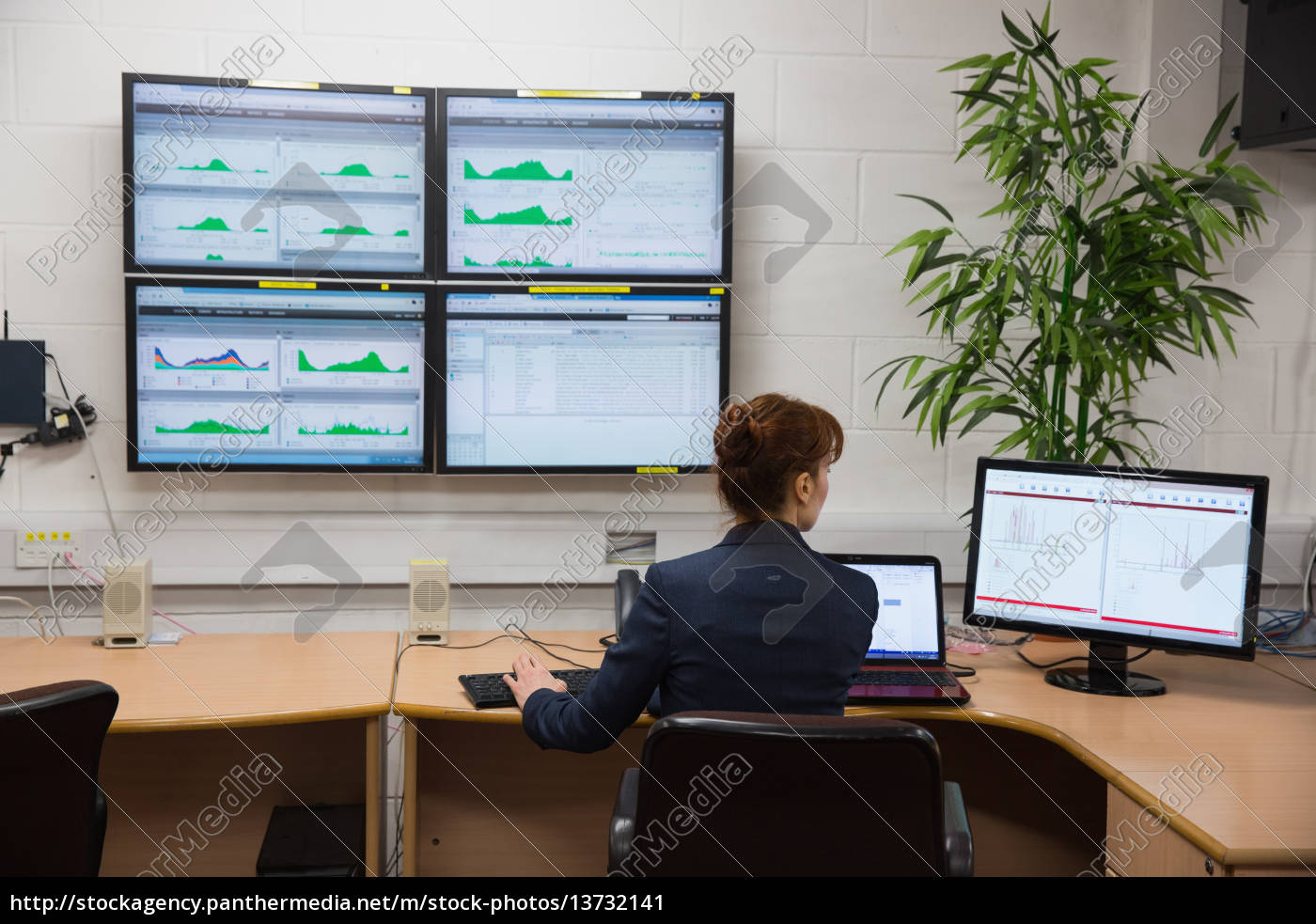 technician, sitting, in, office, running, diagnostics - 13732141