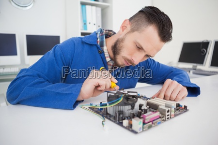 computer engineer working on cpu with