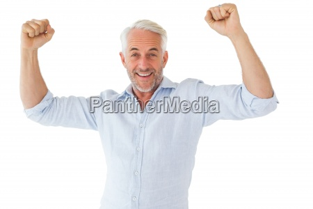 smiling man cheering at camera
