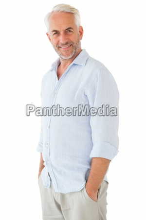smiling man posing with hands in