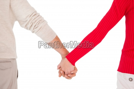 couple holding hands rear view