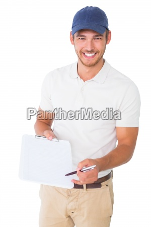 happy delivery man holding clipboard