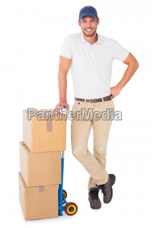 happy delivery man leaning on trolley