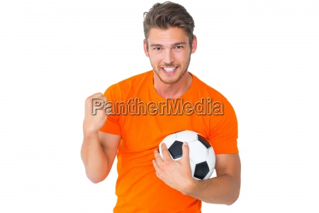 excited man in orange cheering holding