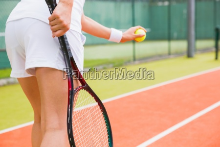 tennis player getting ready to serve