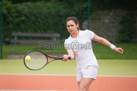 tennis player playing on the court