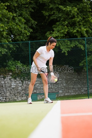 pretty tennis player ready to serve