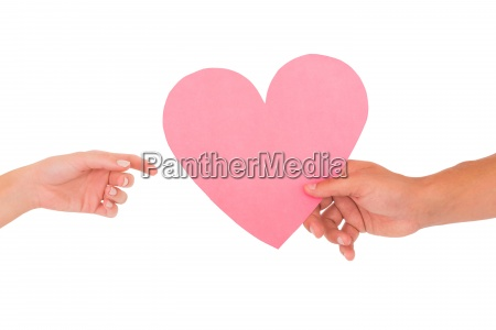 couple, passing, a, paper, heart - 13736137