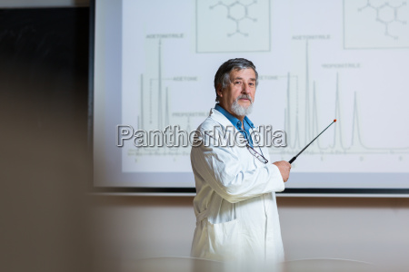 senior chemistry professor giving a lecture