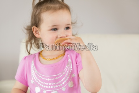 close up of cute girl eating
