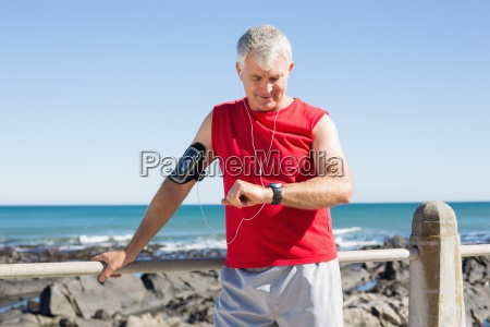 fit mature man warming up on