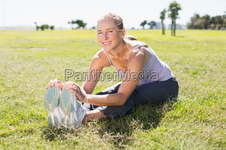 fit mature woman warming up on