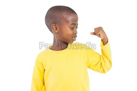 happy little boy flexing arm