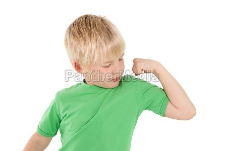 cute little boy flexing his arm