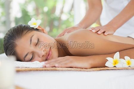 beautiful brunette enjoying a shoulder massage