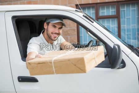 delivery driver offering parcel from his