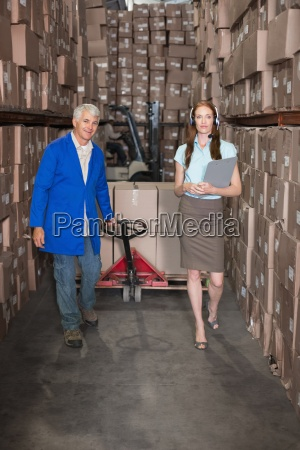 warehouse manager walking with foreman pulling