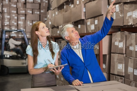 warehouse manager and foreman working together