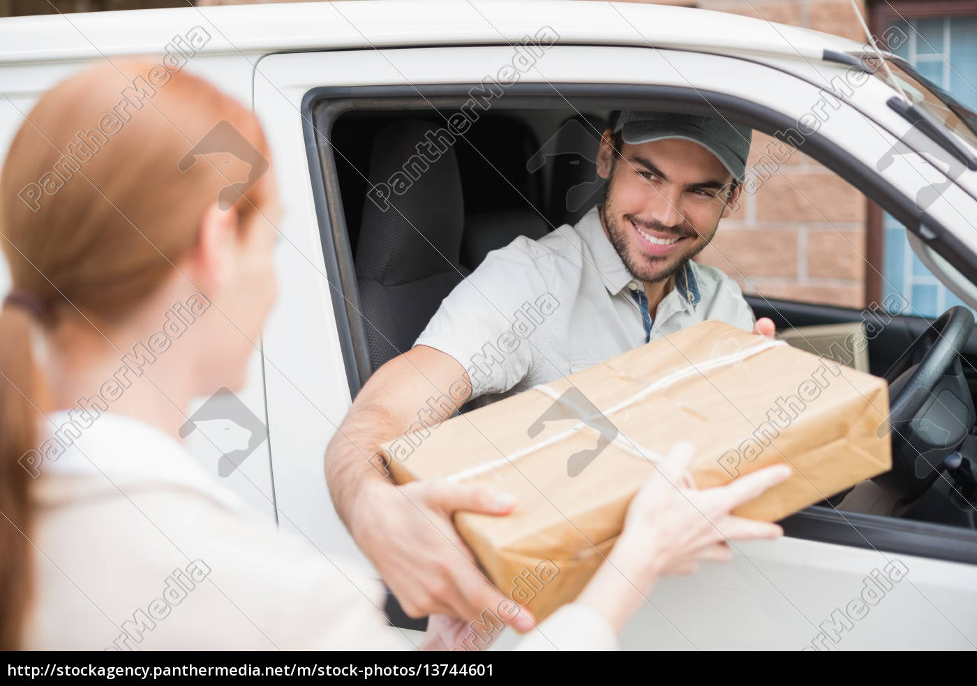 delivery, driver, handing, parcel, to, customer - 13744601