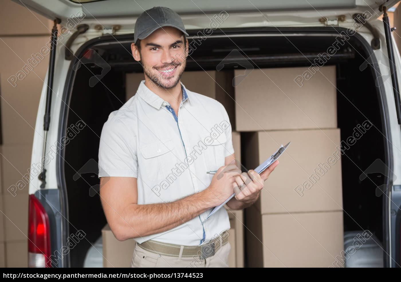 delivery, driver, smiling, at, camera, beside - 13744523